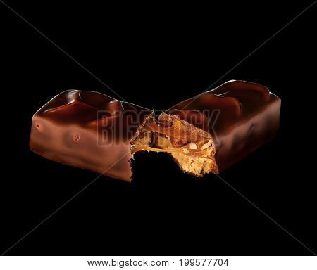 Original chocolate with delicious taste with caramel on a black background
