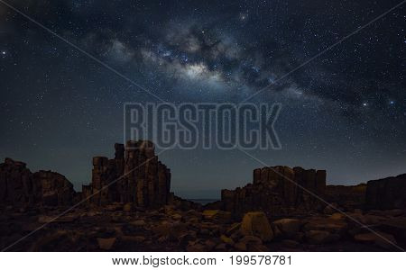 Milky way at basalt rock formations with a view to the sea at Bombo Headland quarry New South Wales Australia