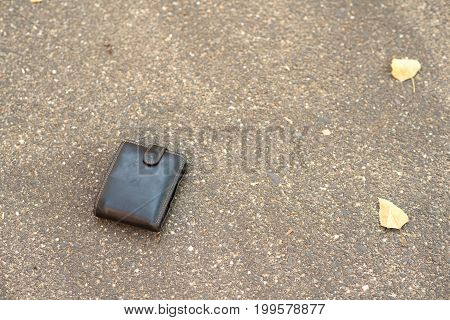Brown Leather Wallet On The Pavement
