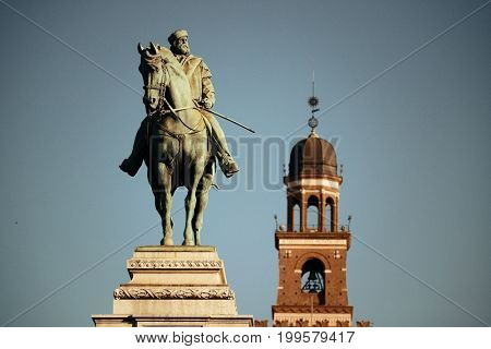 Giuseppe Garibaldi Monument and the bell tower of Sforza Castle in Milan, Italy.
