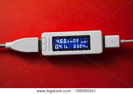 battery tester diagnostic tool, red background