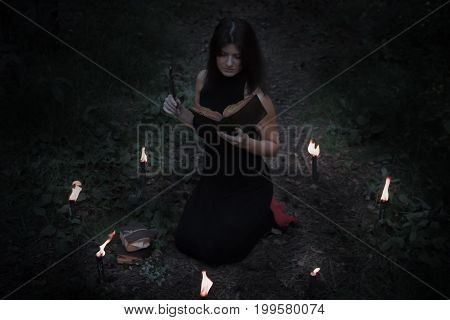 Halloween Concept. Fairy In Black. In The Witchy Circle