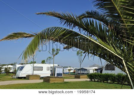 Campers And Caravans At A Camping.