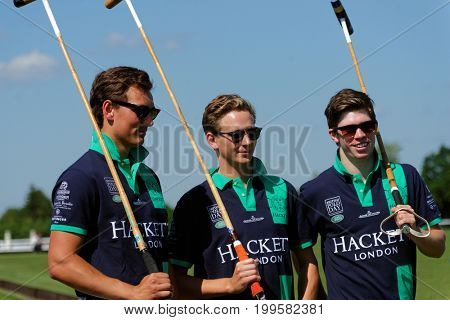 TSELEEVO, MOSCOW REGION, RUSSIA - JULY 26, 2014: Oxbridge Polo Team with clubs before the match during the British Polo Day. Oxbridge beat Tseleevo Polo Club 5-4