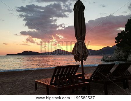 Sunset on the beach Beach chair and beach umbrella Sunrise and sea landscape nature background