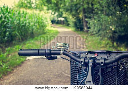Bike Path And Bicycle Handlebar Close-up. Bicycle Friendly City.