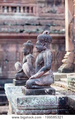 Ancient stone statues in Banteay Srey Temple in Angkor Area, Cambodia. Banteay Srey is a 10th century Cambodian temple dedicated to the God Shiva.