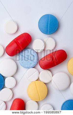 Macro shot of colorful medicaments, top view. Multicolored medical pills.