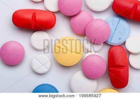 Different multicolored medicaments on white background. Antibiotic, painkiller medicine pills. Pharmaceutical medicaments.
