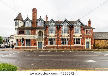 Northampton, UK - Aug 08, 2017: Cloudy rainy day view of The Plough Hotel Northampton Town Centre.