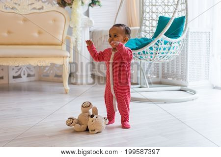 Full length portrait of mixed race baby boy in the home.