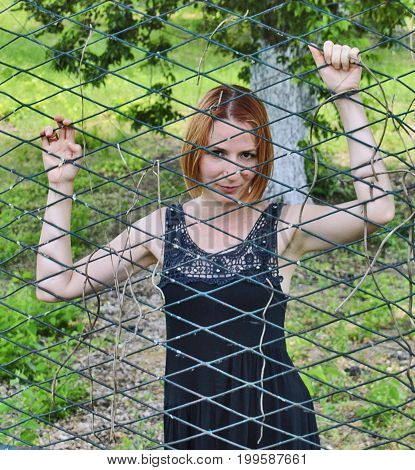 Giirl Behind The Iron Net