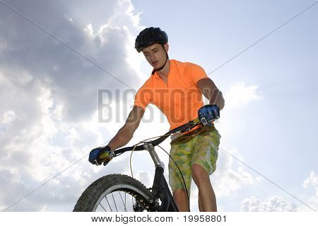 bicyclist afoot