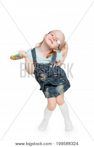 Little girl with big lollipop isolated on white background