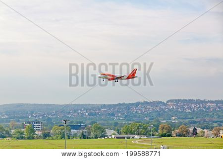 Airplane During Landing At Airport Stuttgart, Germany