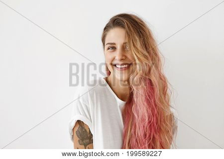 Lovely Female With Pure Skin, Blue Shining Eyes And Pink Hair Tips, Wearing Casual T-shirt, Smiling