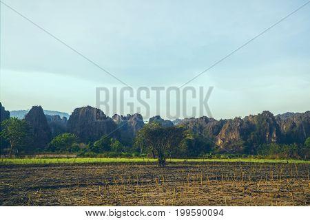 Rural landscape. Fields in season Natural rocky mountains