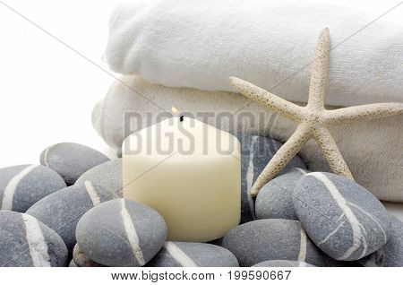 Tropical setting and starfish towel, candle pile of striped stones