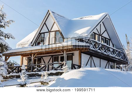 Snow-covered Wooden Building