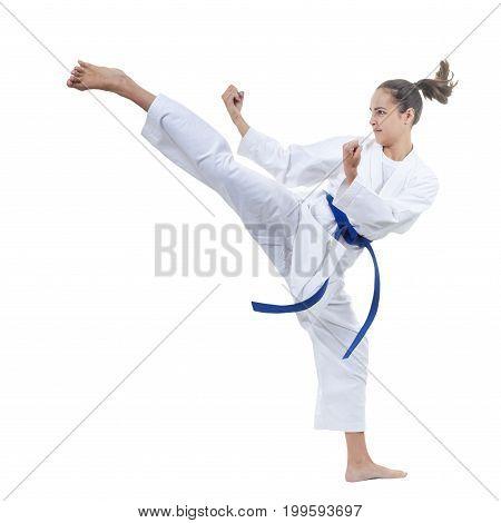 On a white background the sportswoman beats a kick