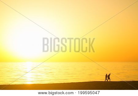 loving couple at sunset on the beach
