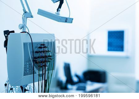 Modern equipment. The focus being on a modern electroencephalograph standing in the diagnostic laboratory