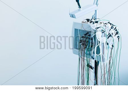 Brand-new device. Modern electroencephalograph of high quality standing in the laboratory, being isolated on white background