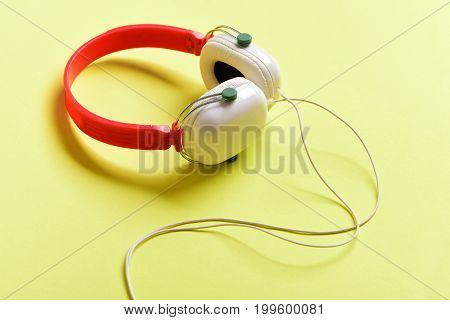 Music Accessories And Technology Concept. Headphones In White And Red