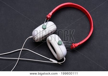 Hobby, Leisure And Music Concept. Headphones In White And Red