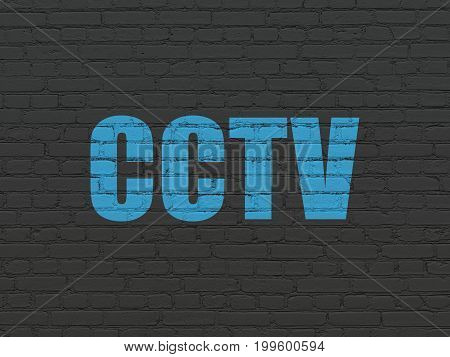 Safety concept: Painted blue text CCTV on Black Brick wall background
