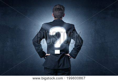 Businessman standing and thinking about questions