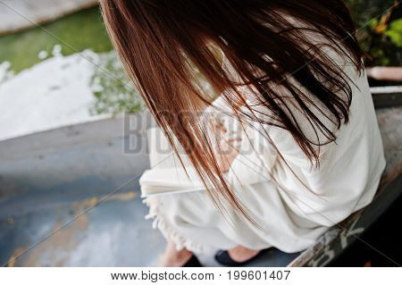 Close-up Photo Of Woman's Back While Reading A Book In A Boat.