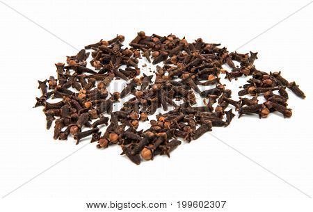 Clove spice. Carnation seasoning. A pile of carnations isolated on a white background. Natural spices