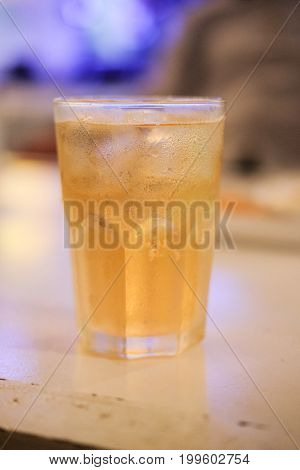 Close up glass of beer on the table in pub