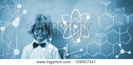Digital image of atomic structure  against boy dressed as senior teacher in front of blackboard