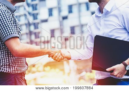 successful business people handshaking closing a deal , business team partnership concept