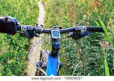The image Bicycle handlebar Bike ride in the forest trail