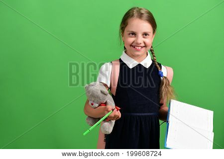 Pupil In School Uniform With Braids And Backpack