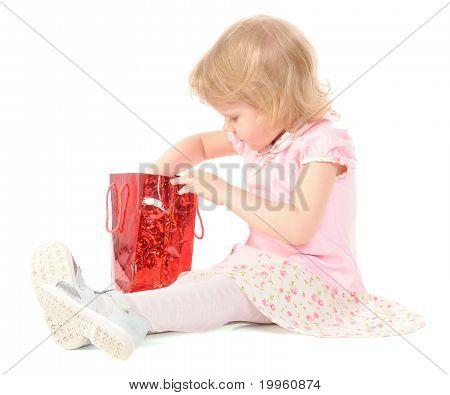 Little Girl Looking In Gift Bag