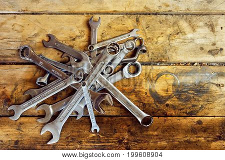 the image a pile of wrenches on wooden table