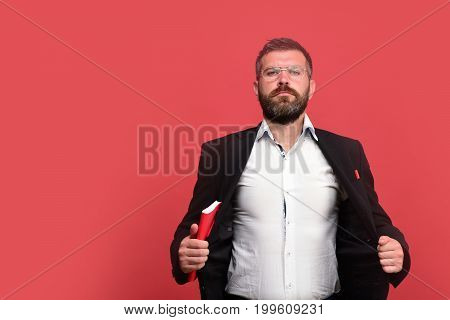 Man In Classic Outfit With Beard Holds Red Book