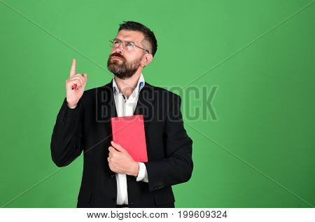 Knowledge And Scheduling Concept. Teacher Wears Glasses And Holds Organizer