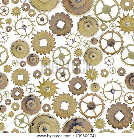seamless background from old brass gears isolated on white
