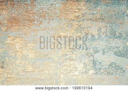 White and golden messy wall stucco texture background. Decorative wall paint.