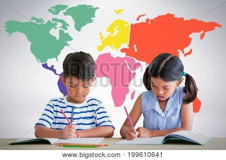 Children writing on books at table against grey background