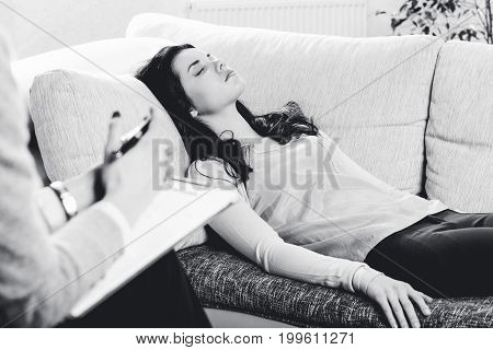 young girl on reception at the psychologist, lies on the sofa