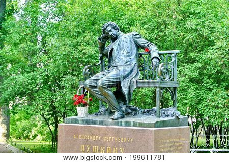 Tsarskoye Selo, St-Petersburg, Russia - July 18, 2017: Monument to great Russian poet Alexander Pushkin in Lyceum garden in Tsarskoye Selo. It opened in 1899. Author of monument sculptor Bach.
