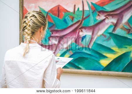 HAMBURG, GERMANY - 9 JULY 2017: Hamburg Kunsthalle art museum. Jung woman in front of painting.