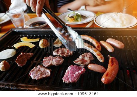 Delicious wagyu meat vegetable and sausage yakiniku barbecue grill on oven