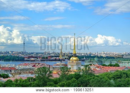Main tower of Admiralty and Peter and Paul Cathedral against the blue sky. View of Saint Petersburg from the from the colonnade of St. Isaac's Cathedral.